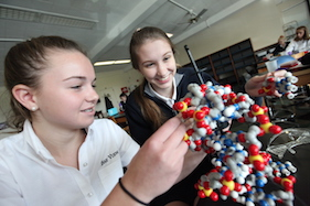 Upper School students playing with DNA strand